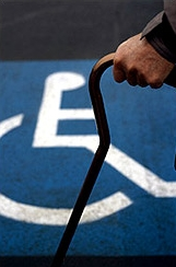 Disabled person with a cane